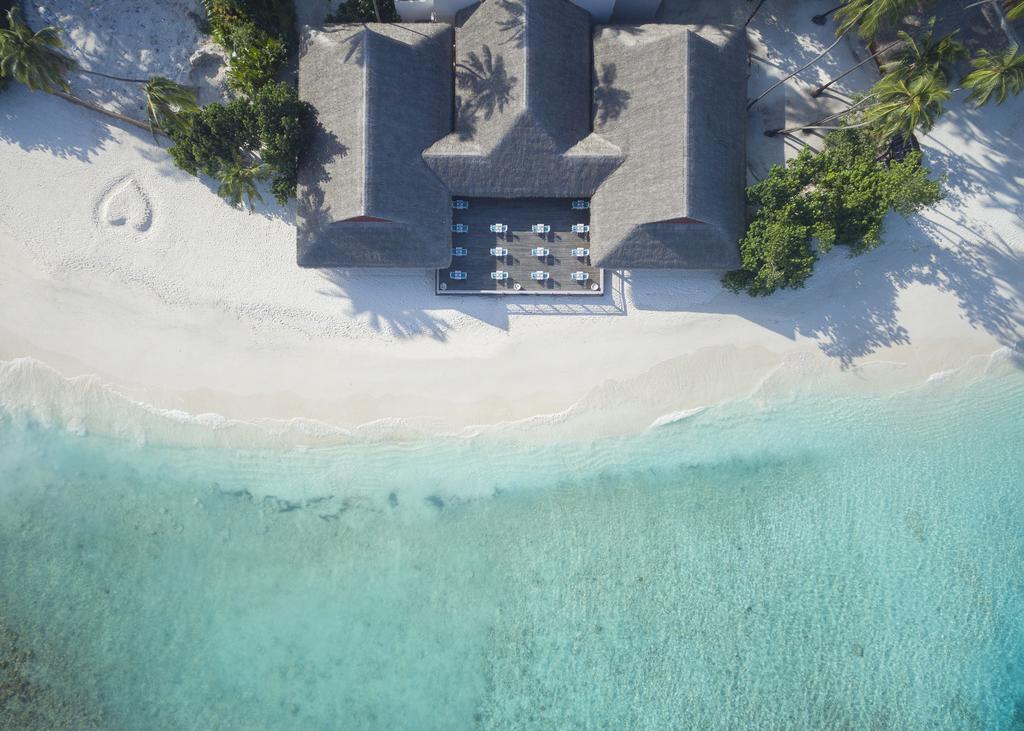 Отель Malahini Kuda Bandos, Мальдивы
